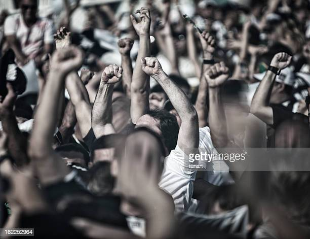 cheering people - fist stock pictures, royalty-free photos & images