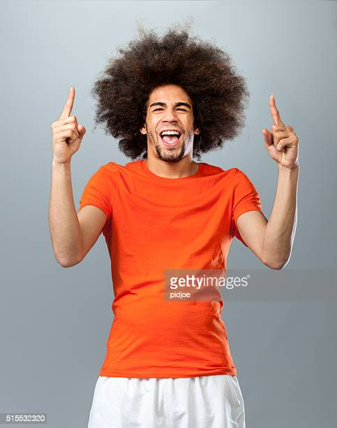 cheering soccer  fan - fan enthusiast stock photos and pictures