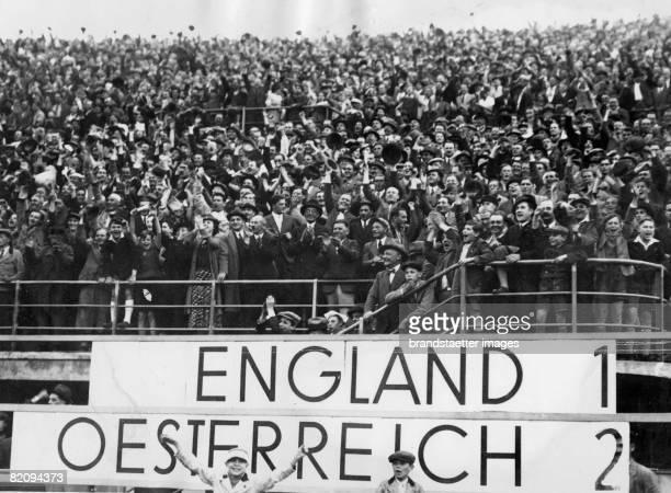 Cheering spectators at the soccer match Austria versus England Photograph Around 1935 [Jubelde Zuschauer nach dem Fuballspiel England gegen sterreich...