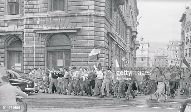 Cheering students some carrying banners march through the streets of Trieste after hearing the news of the agreement between Italy and Yugoslavia...