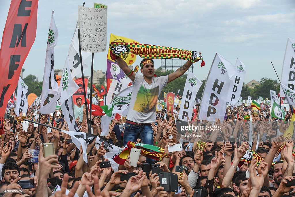 Cheering supporters of Turkey's pro-Kurdish People's Democtratic Party (HDP) leader Selahattin Demirtas as he addresses a rally ahead of the June 7 general elections on May 30, 2015 in Istanbul, Turkey. Turkey will hold general election on June 7, 2015. Although it is a relatively small party, all eyes will be on HDP. If it reaches the minimum 10 percent threshold required for entering parliament as a party, it could effectively thwart Turkey's President Recep Tayyip Erdogans ambition to lead a presidential system following a constitutional change.