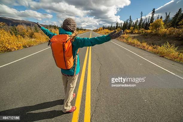 Cheering traveling woman enjoying freedom