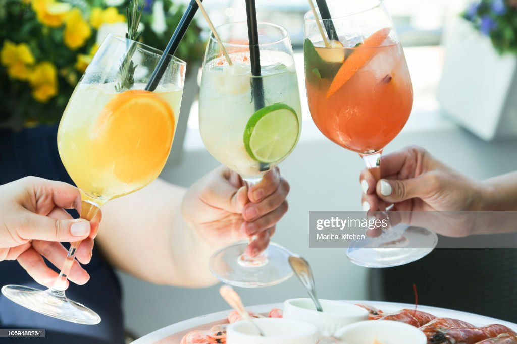 Cheering with cocktails : Stock Photo