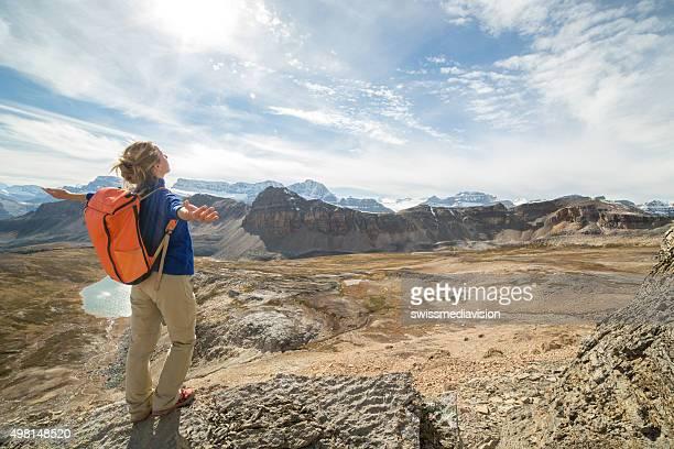 Cheering woman celebrating on mountain top
