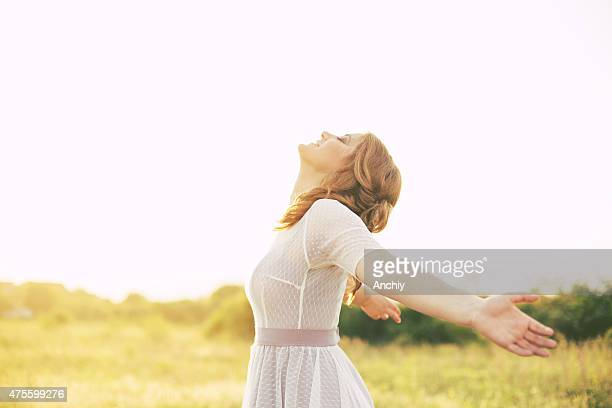 cheering woman open arms under sunrise - arms outstretched stock pictures, royalty-free photos & images