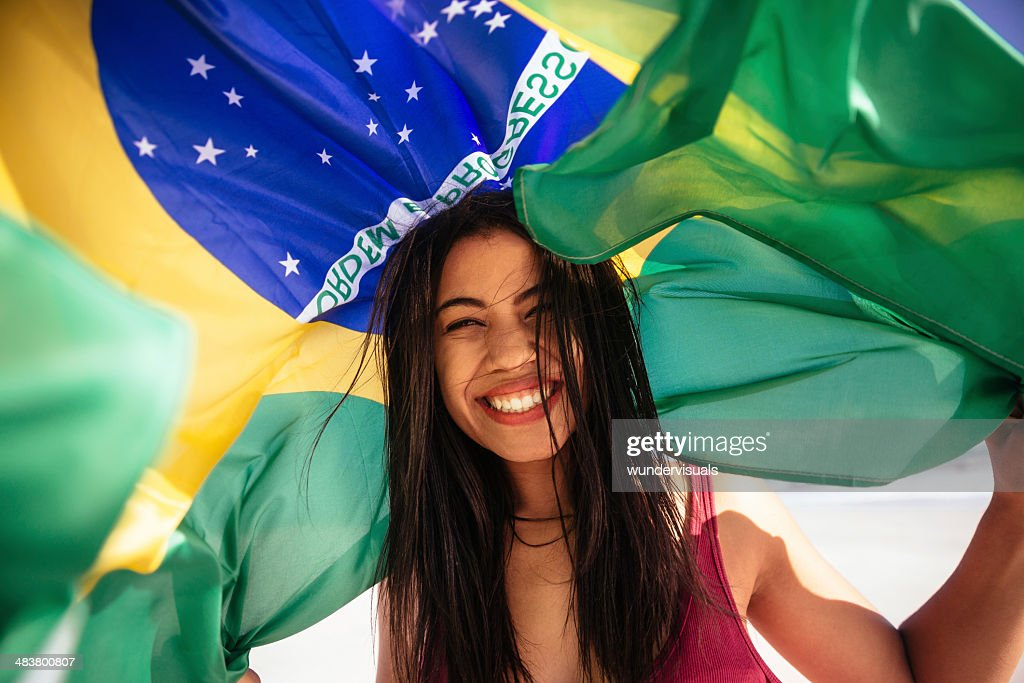 Cheering woman under brazilian flag : Stock Photo