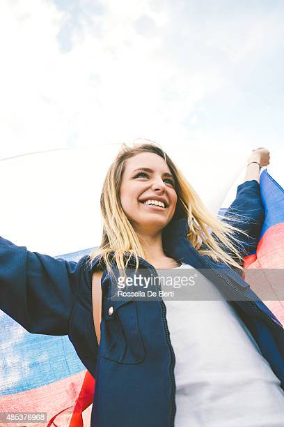 Cheering Woman Under Russian Flag