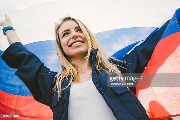 cheering woman under russian flag - russian culture stock pictures, royalty-free photos & images