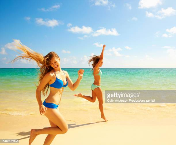 Cheering women running on beach