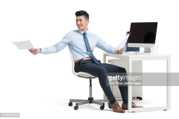 cheering young businessman working in office - shirt and tie stock pictures, royalty-free photos & images