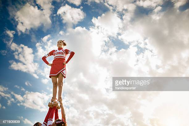 cheerleadear on top of the success - pyramid stock pictures, royalty-free photos & images