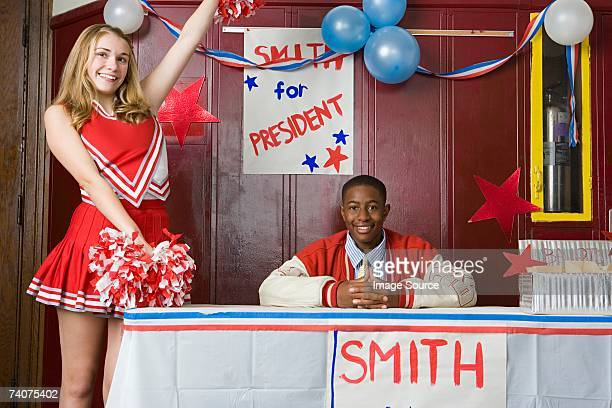 cheerleader and boy running for president - black cheerleaders stock photos and pictures