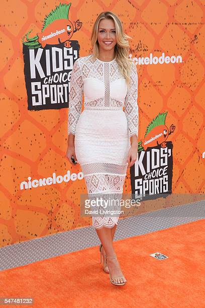 NFL cheerleader Camille Kostek arrives at the Nickelodeon Kids' Choice Sports Awards 2016 at the UCLA's Pauley Pavilion on July 14 2016 in Westwood...