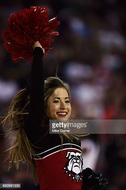A cheerleader cheers on the Georgia Bulldogs during their basketball game against the South Carolina Gamecocks at Stegeman Coliseum on January 4 2017...