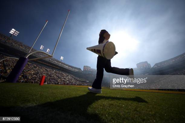 A cheerleader crosses the field prior to the Arkansas Razorbacks playing the LSU Tigers at Tiger Stadium on November 11 2017 in Baton Rouge Louisiana