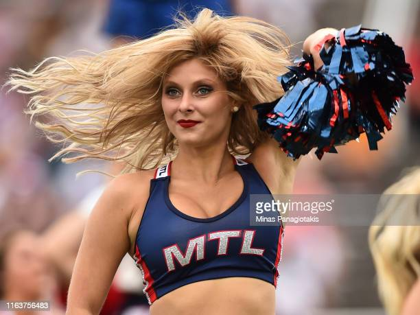 Cheerleader entertains the fans between the Montreal Alouettes and the Edmonton Eskimos during the CFL game at Percival Molson Stadium on July 20,...