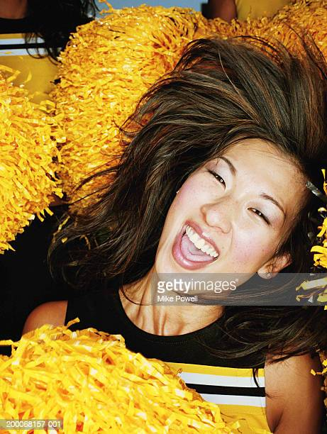 cheerleader flipping hair, laughing, portrait, close-up - asian cheerleaders stock photos and pictures