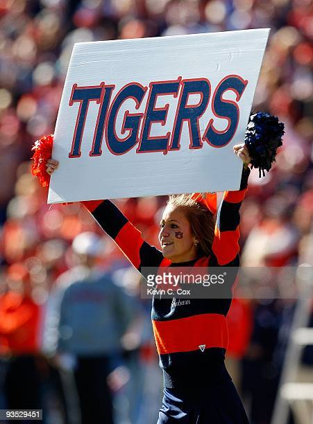 A cheerleader for the Auburn Tigers peforms before the game against the Alabama Crimson Tide at JordanHare Stadium on November 27 2009 in Auburn...