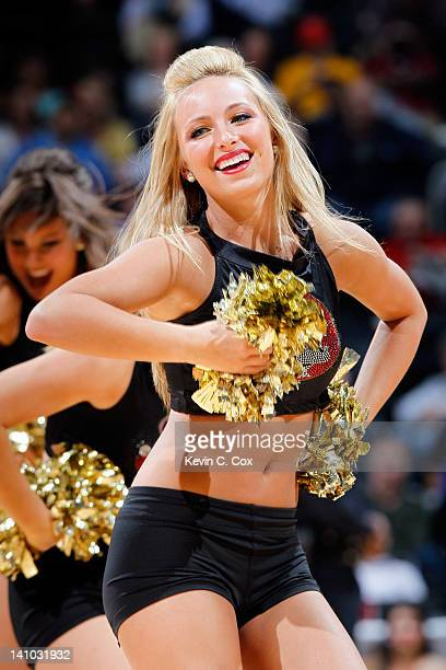 A cheerleader for the Florida State Seminoles performs against the Miami Hurricanes in their Quarterfinal game of the 2012 ACC Men's Basketball...