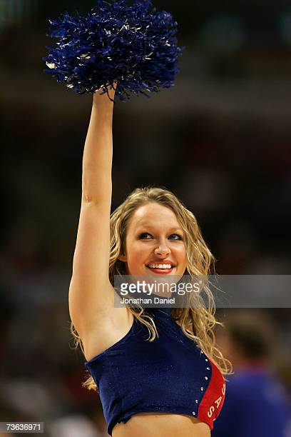 A cheerleader for the Kansas Jayhawks performs against the Kentucky Wildcats during the second round of the NCAA Men's Basketball Tournament at the...