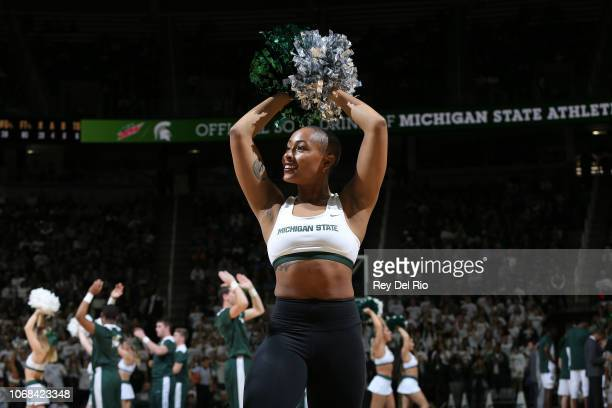 A cheerleader for the Michigan State Spartans performs against the Louisiana Monroe Warhawks at Breslin Center on November 14 2018 in East Lansing...