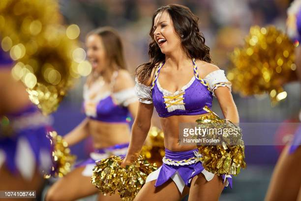 A cheerleader for the Minnesota Vikings performs during the game between the Minnesota Vikings and the Green Bay Packers at US Bank Stadium on...