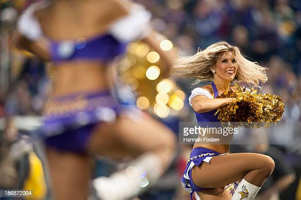 A cheerleader for the Minnesota Vikings performs during the game between the Minnesota Vikings and the Green Bay Packers on October 27 2013 at Mall...