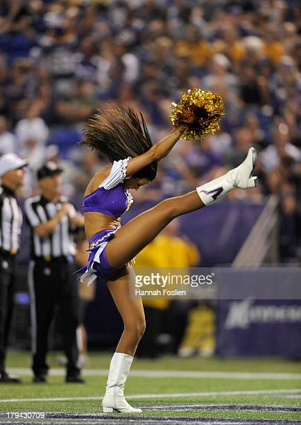 A cheerleader for the Minnesota Vikings performs during the second half of the game between the Minnesota Vikings and the Tennessee Titans on August...