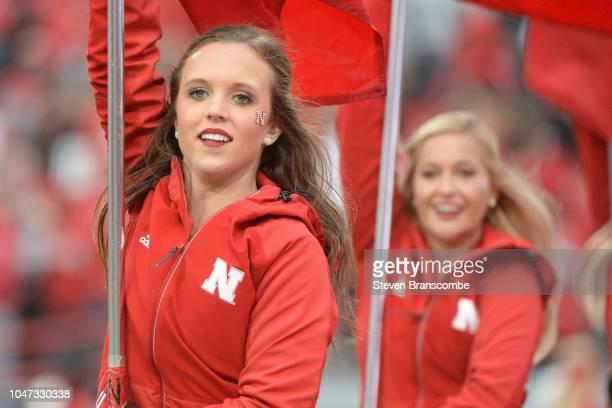 A cheerleader for the Nebraska Cornhuskers celebrates against the Purdue Boilermakers at Memorial Stadium on September 29 2018 in Lincoln Nebraska
