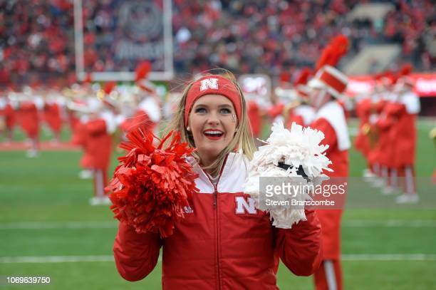 A cheerleader for the Nebraska Cornhuskers performs before the game against the Michigan State Spartans at Memorial Stadium on November 17 2018 in...