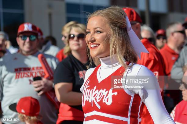 A cheerleader for the Nebraska Cornhuskers performs before the game against the Iowa Hawkeyes at Memorial Stadium on November 24 2017 in Lincoln...