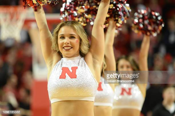 A cheerleader for the Nebraska Cornhuskers performs during a break in the game against the Michigan State Spartans at Pinnacle Bank Arena on January...