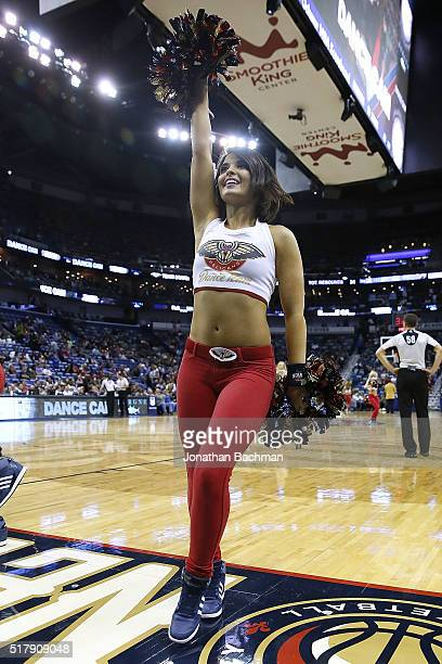 A cheerleader for the New Orleans Pelicans performs during a game during a game at the Smoothie King Center on March 26 2016 in New Orleans Louisiana...