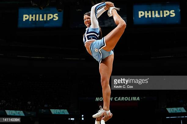 A cheerleader for the North Carolina Tar Heels performs against the Florida State Seminoles during the Final Game of the 2012 ACC Men's Basketball...