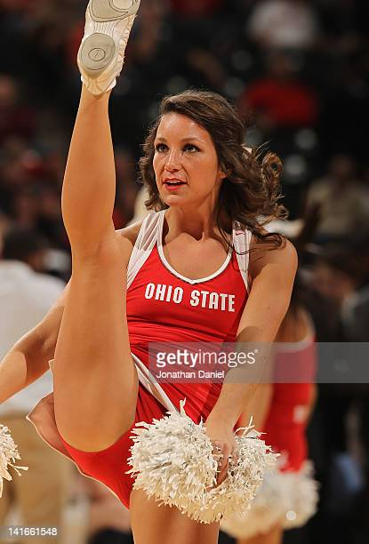 A cheerleader for the Ohio State Buckeyes percforms as the Buckeyes take on the Michigan Wolverines during their Semifinal game of the 2012 Big Ten...
