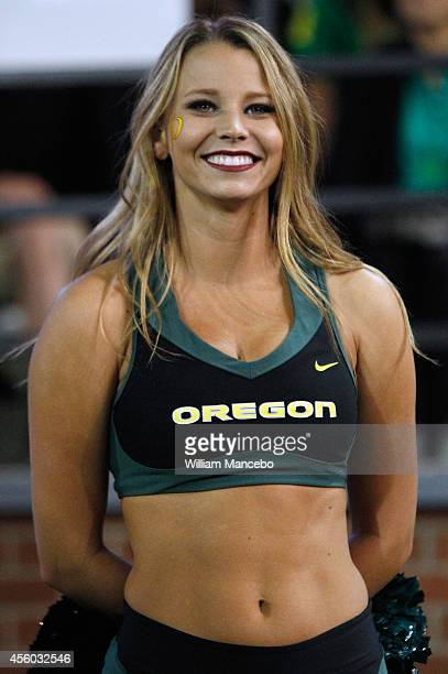 A cheerleader for the Oregon Ducks looks on during the game against the Washington State Cougars at Martin Stadium on September 20 2014 in Pullman...