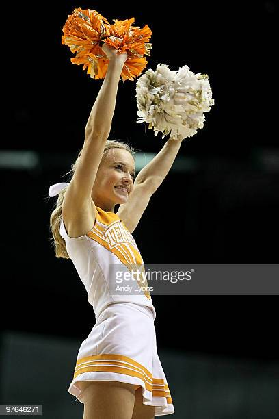 A cheerleader for the Tennessee Volunteers performs against the LSU Tigers during the first round of the SEC Men's Basketball Tournament at the...