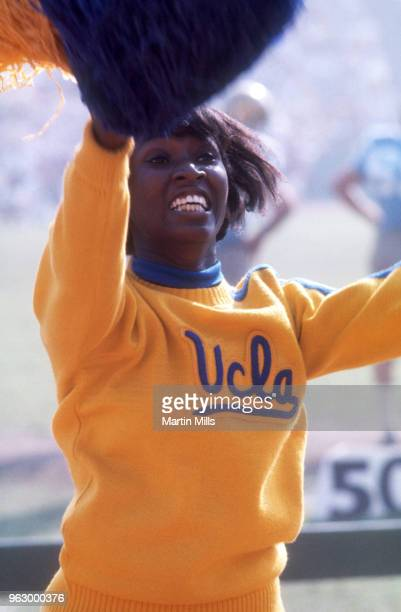 Cheerleader for the University of California Los Angeles Bruins celebrates with her pom-poms during an NCAA game circa 1970's at the Los Angeles...