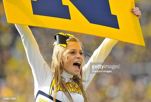 A cheerleader for the University of Michigan cheer on the sideline during a game between the Ohio State Buckeyes and Michigan Wolverines at Michigan...