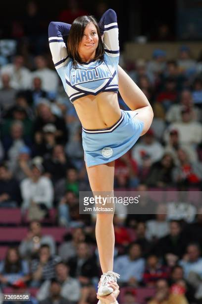 A cheerleader for the University of North Carolina Tar Heels performs during a break in play against the Georgetown Hoyas during the NCAA Men's East...