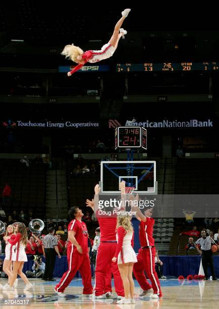 A cheerleader for the Utah Runnin' Utes is launched into the air by members of her squad as the Utes face the Brigham Young University Cougars during...