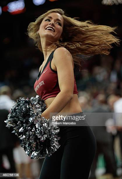 A cheerleader for the Washington State Cougars performs during the game against the Gonzaga Bulldogs in the second half at Spokane Veterans Memorial...