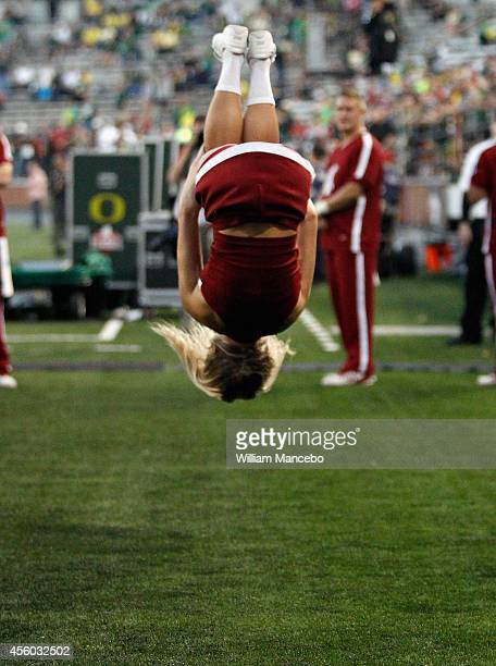 A cheerleader for the Washington State Cougars warms up prior to the game against the Oregon Ducks at Martin Stadium on September 20 2014 in Pullman...