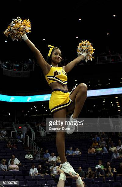 A cheerleader for the West Virginia Mountaineers cheers on the crowd before the team takes on the Xavier Musketeers in the West Regional Sweet 16...