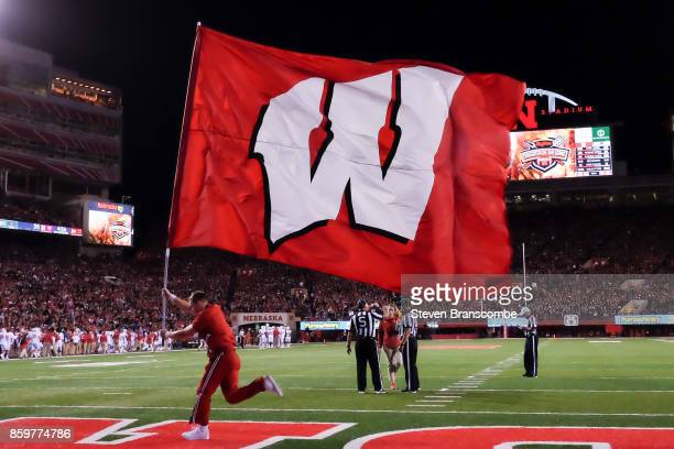 A cheerleader for the Wisconsin Badgers celebrates a score against the Nebraska Cornhuskers at Memorial Stadium on October 7 2017 in Lincoln Nebraska