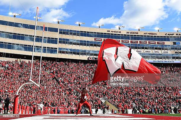 A cheerleader for the Wisconsin Badgers waves the flag following a touchdown against the Purdue Boilermakers at Camp Randall Stadium on October 17...
