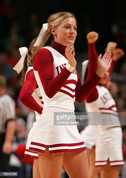 A cheerleader from the Indiana Hoosiers supports her team against the Illinois Fighting Illini during the quarterfinals of the Big Ten Men's...