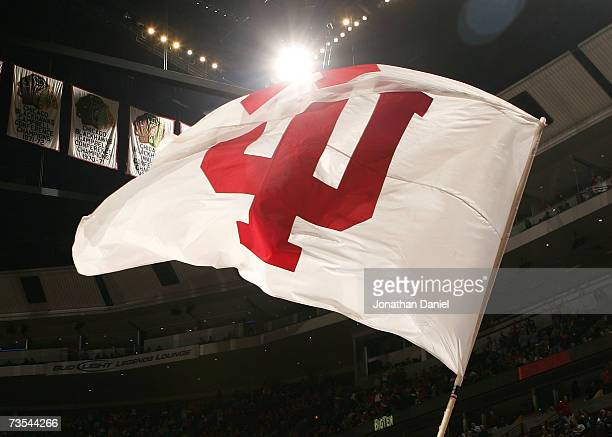 Cheerleader from the Indiana Hoosiers waves a flag with Indiana's logo on the court against the Illinois Fighting Illini during the quarterfinals of...