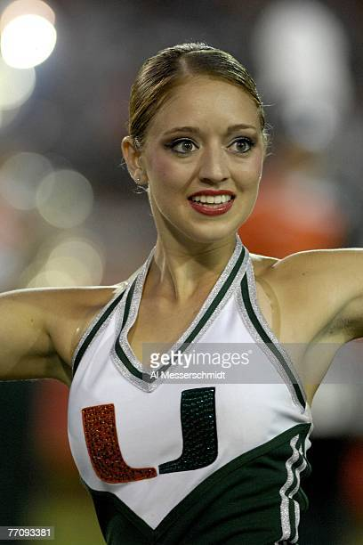 A cheerleader from the University of Miami Hurricanes entertains during play against the Texas AM Aggies at the Orange Bowl on September 20 2007 in...