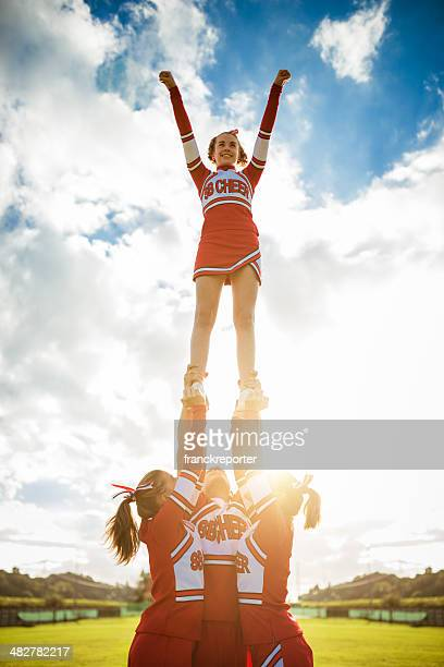 Cheerleader girl on top of the success